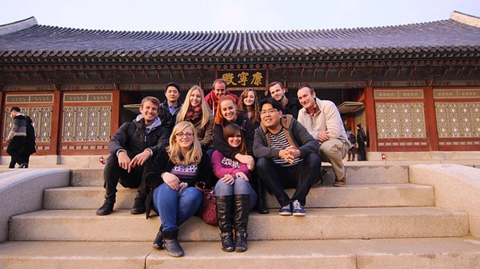 Teachers in South Korea on a cultural orientation tour at the Gyeongbokgung Palace.